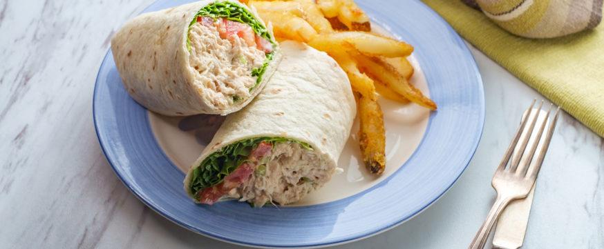 Tuna wrap sandwich with french fried potatoes
