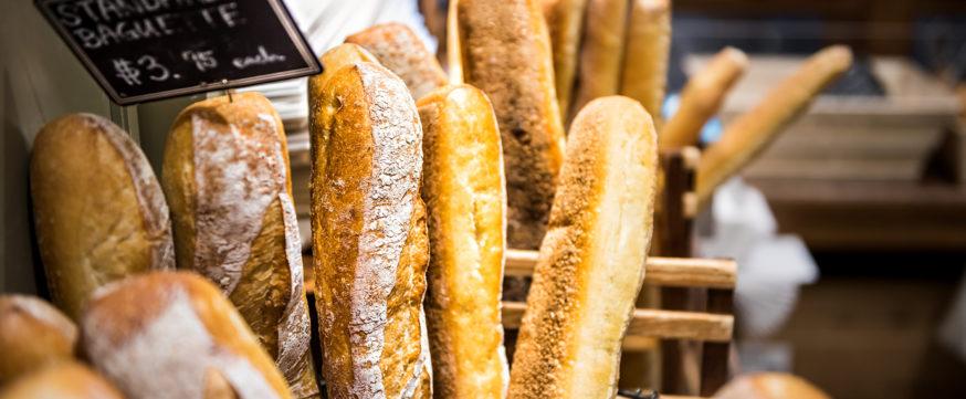 Closeup of fresh golden standard baked baguette loaves in bakery basket